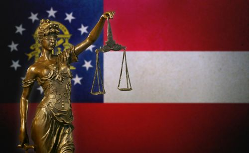Lady Justice before a flag of Georgia